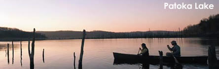 Patoka Lake - Photo features 2 boaters in a Canoe paddling on Patoka Lake during sunset